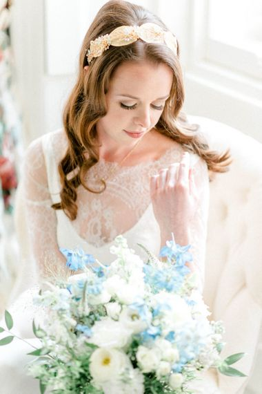 Beautiful Bride on the Wedding Morning Looking at Her Bouquet