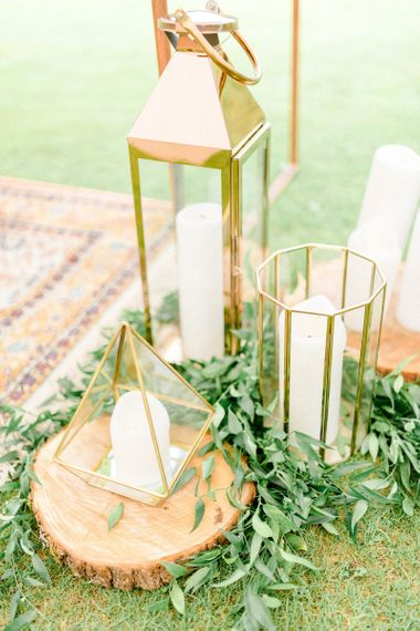 Candles in Gold Storm Lanterns and Terrariums wedding Decor