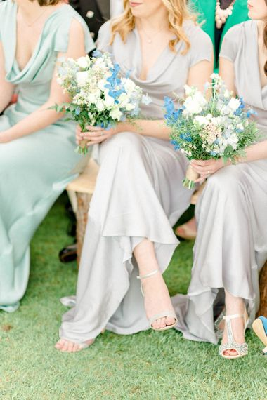 Bridesmaids Sitting at the Wedding Ceremony in their Satin Dresses