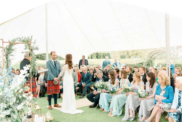 Bride and Groom Saying Their Vows at Their Outdoor Wedding Ceremony