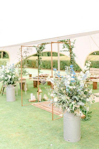 Copper Frame Wedding Altar with Flowers in Milk Churns
