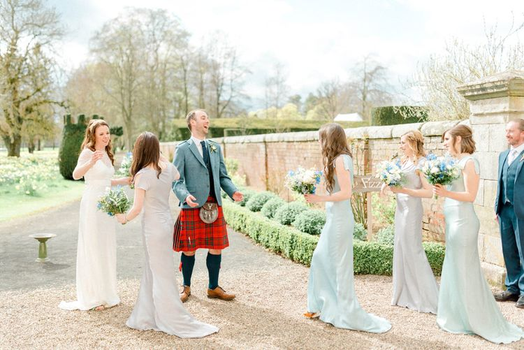 Bride and Groom Congratulated by the Wedding Party After Getting Married