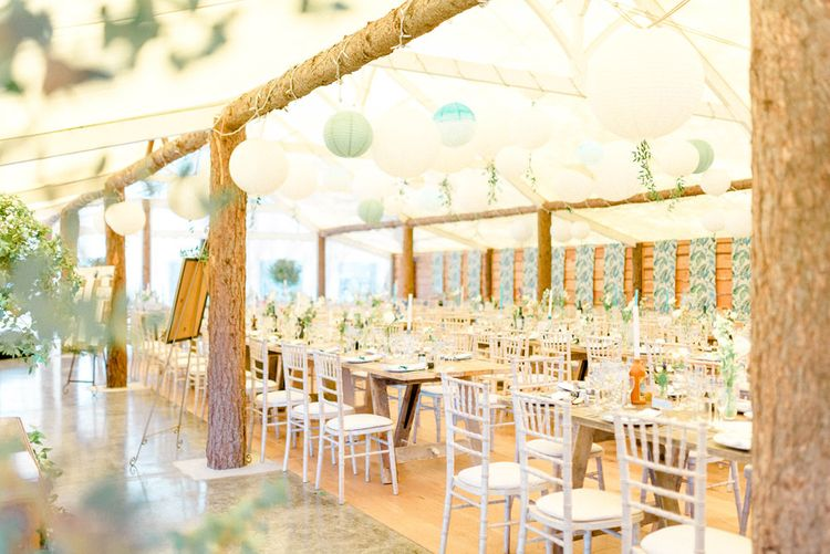 Green and White Barnquee Wedding Reception Decor with Hanging Paper Lanterns