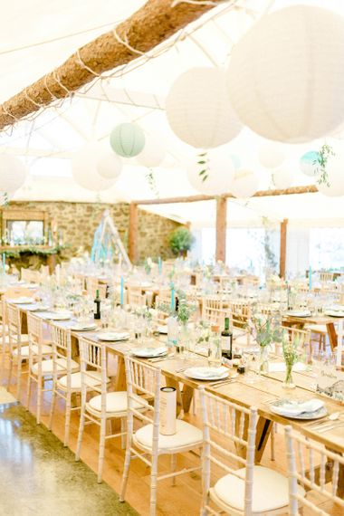 Long Tables at Wedding Reception with Hanging Paper Lanterns