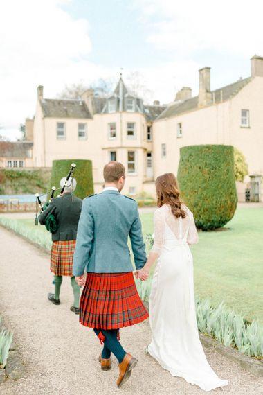 Bag Piper Procession Through Wedding Venue Gardens