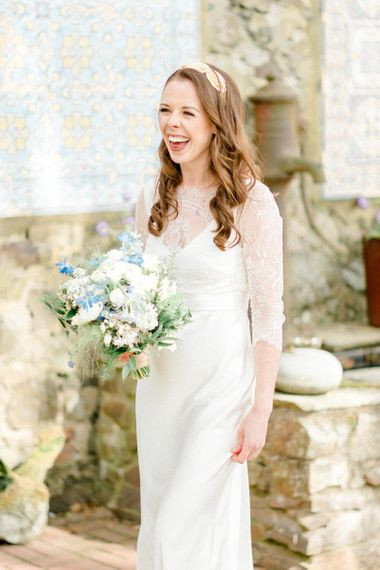 Beautiful Bride in Lace Charlie Bread Wedding Dress and Blue and White Wedding Bouquet