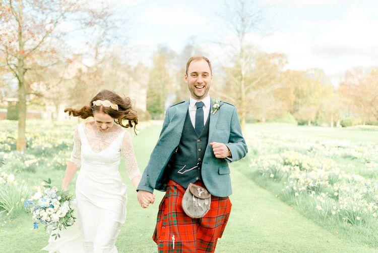 Bride in Charlie Brear Gown and Groom in Tartan Kilt Laughing