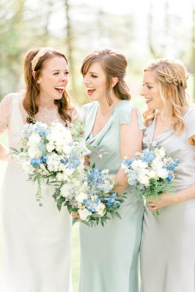 Bridal Party Laughing Holding Blue and White Wedding Bouquets