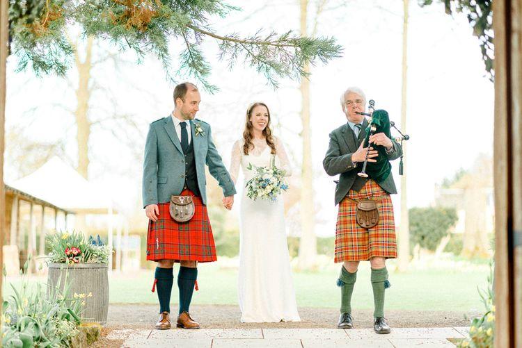 Bride and Groom Wedding Reception Entrance with Bag Piper