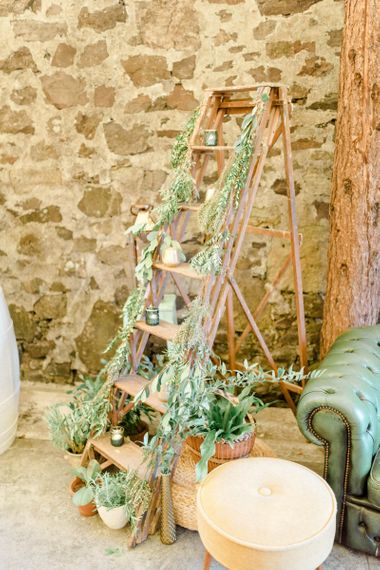 Vintage Step Ladder Covered in Foliage and Candles Wedding Reception Decor