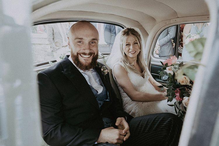 Bride & Groom In Vintage Wedding Car