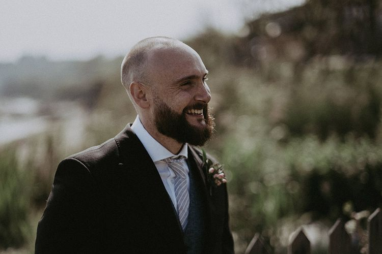 Groom at Beach Wedding with Floral Button Hole