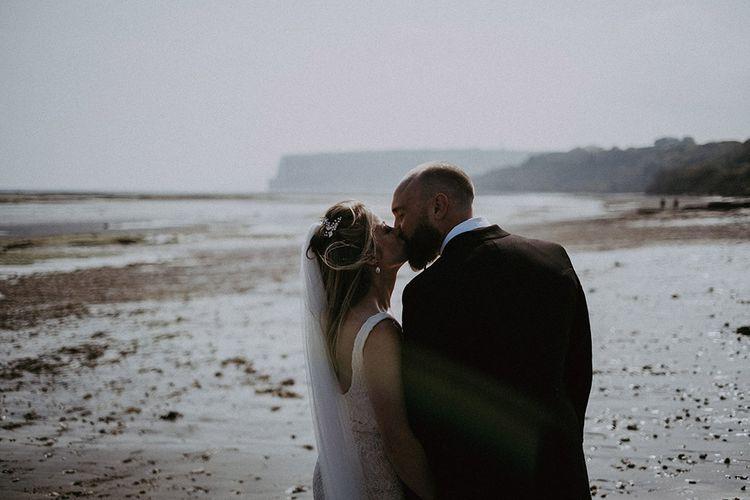 Bride & Groom Kiss on Beach for Isle of Wight Wedding
