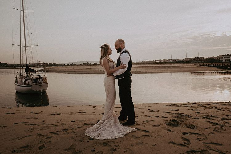 Bride and Groom in Beach Wedding with Boat