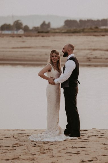 Bride wearing Lace Blush Dress with Groom in Waistcoat