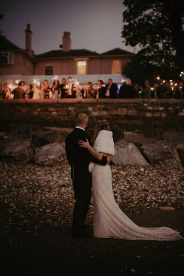 Bride Wearing Wrap for Evening Reception and Guests with Sparklers