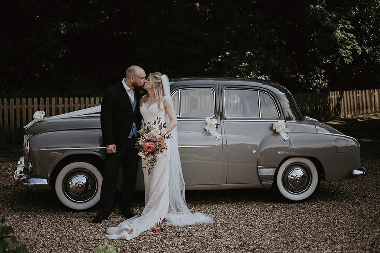 Vintage Wedding Car with Bride & Groom Holding Peony  Bouquet