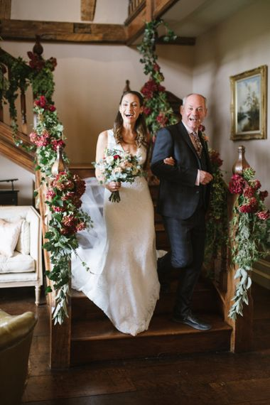 Bride and Father of The Bride Walk Down the Floral Decorated Staircase