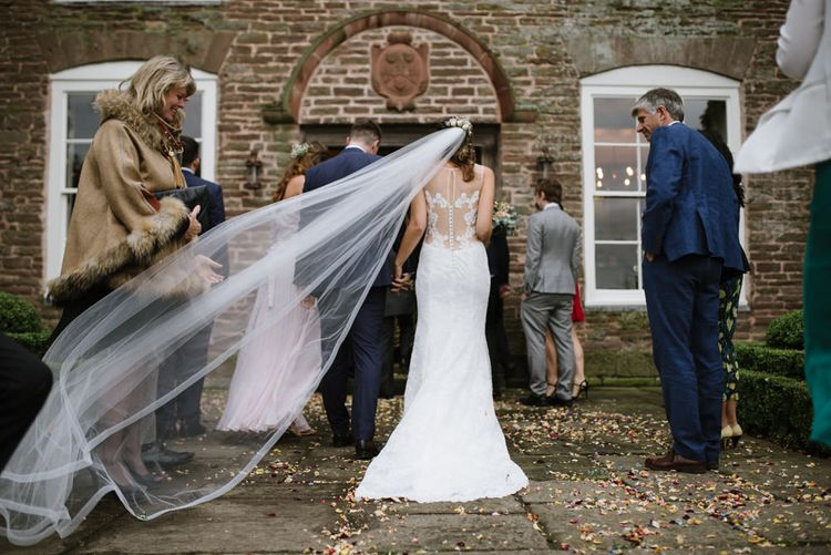 Brides Cathedral Length Veil Blowing in the Wind