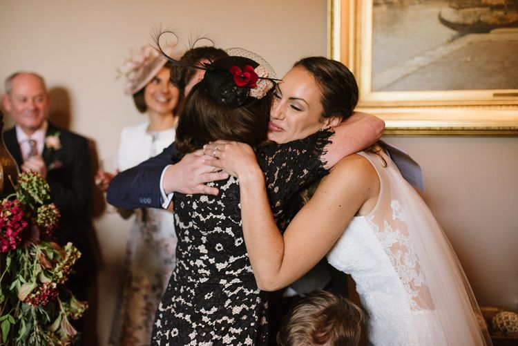 Bride and Wedding Guest Hugging