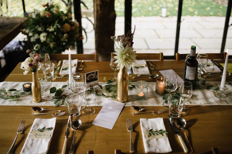 Wedding Reception Table Decor with Gold Spray Painted Bottles, Candle Light and Greenery Decor