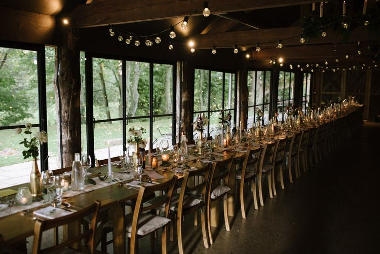 Barn Wedding Reception Decor with Festoon Lights and Candles