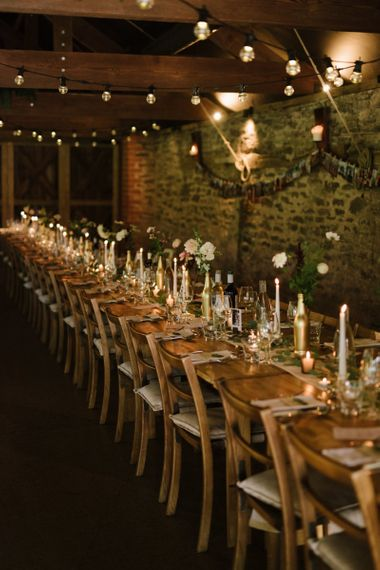 Long Tables with Candlelight and Flowers in Spray Painted Bottles