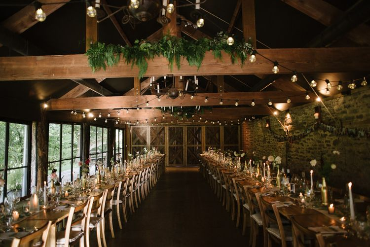 Rustic Barn Wedding Reception Decor with Romantic Candle Light