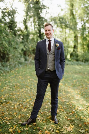 Groom in Navy Ted Baker Suit and Grey Waistcoat