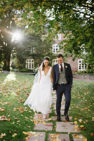 Bride and Groom Wedding Portrait with Autumn Leaves on the Floor