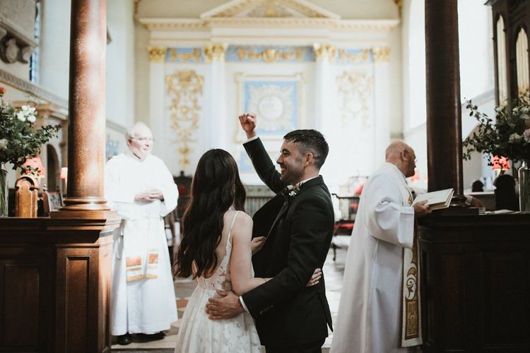 Groom Celebrates Wedding