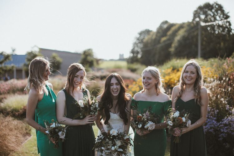 Bridal Party Wearing Green Bridesmaid Dresses