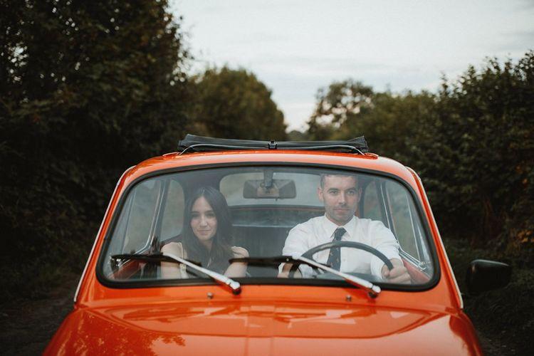 Bride And Groom Drive To Reception In Orange Fiat 500 Wedding Car