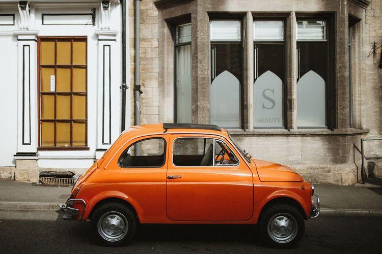 Orange Fiat 500 Wedding Car