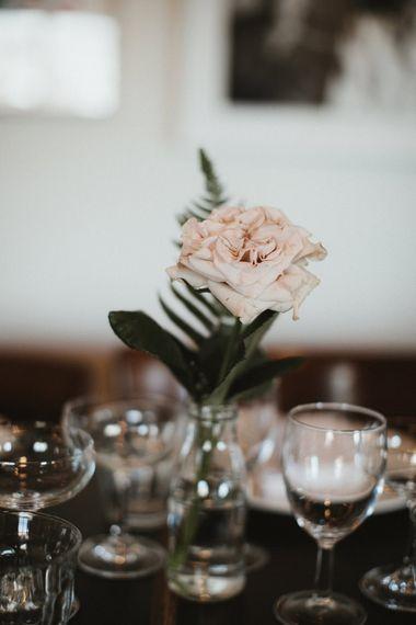 Single Pink Rose Stem in Glass Bottle