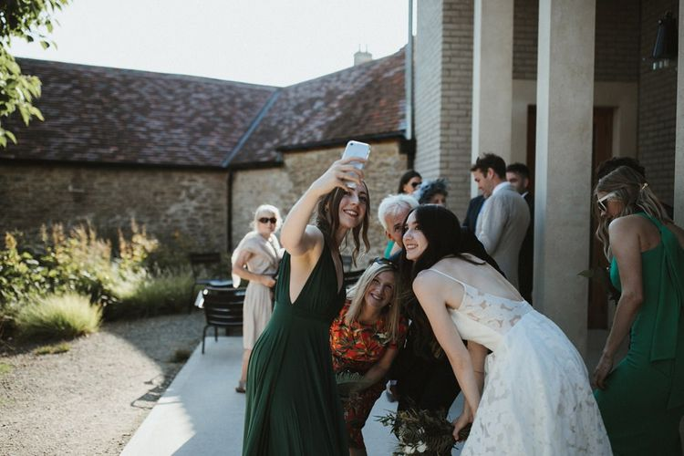 Wedding Guests Take a Selfie With The Bride