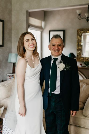 Father of the bride and daughter on the wedding morning