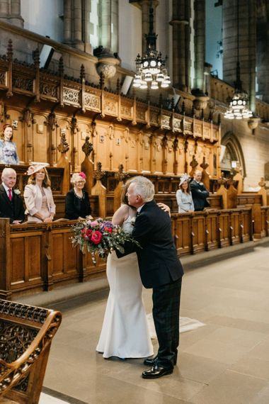 Father of the bride giving his daughter away at Glasgow University Chapel wedding ceremony