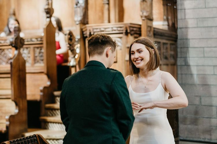 Bride and groom exchanging vows at Glasgow University Chapel  wedding ceremony