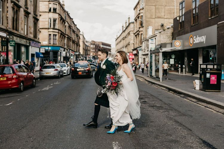 Bride and groom portraits walking around Glasgow