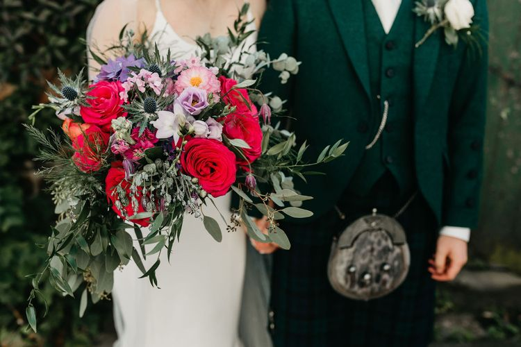 Colourful red, pink and purple wedding bouquet
