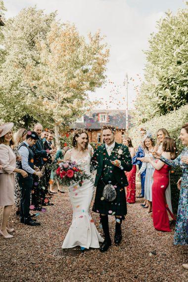 Bride and groom confetti exit