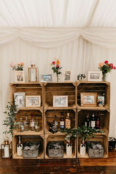 Wooden crate wedding decor  with framed portraits