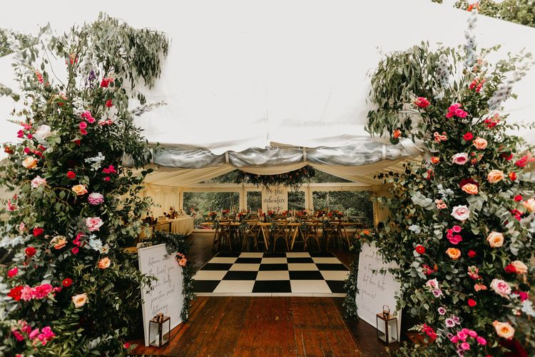 Colourful flowers decorating the marquee entrance