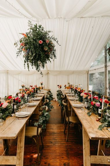 Wooden tables for socially distanced marquee reception