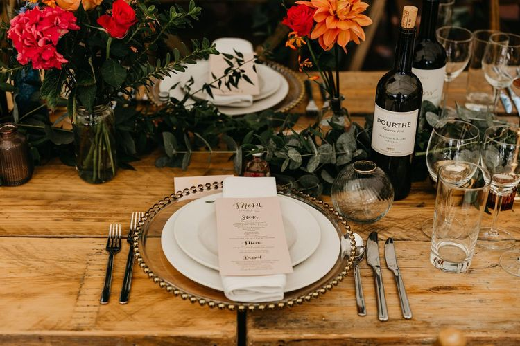 Place setting with glass charger plate