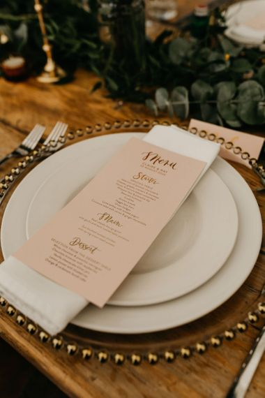 Blush pink menu card at place setting