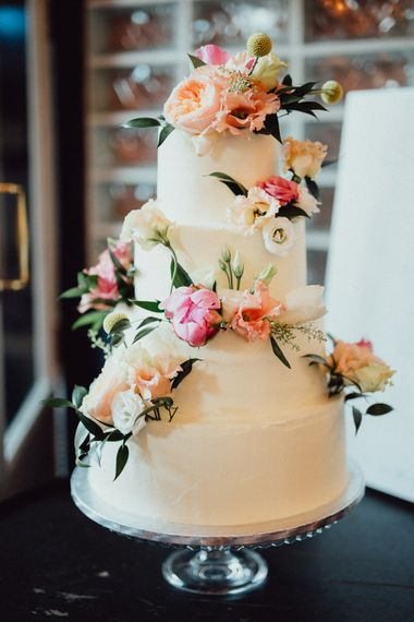 Iced Wedding Cake With Fresh Flowers // Images By Emily & Steve