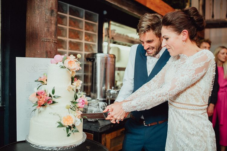 Cutting The Cake Clapton Country Club Wedding // Images By Emily & Steve