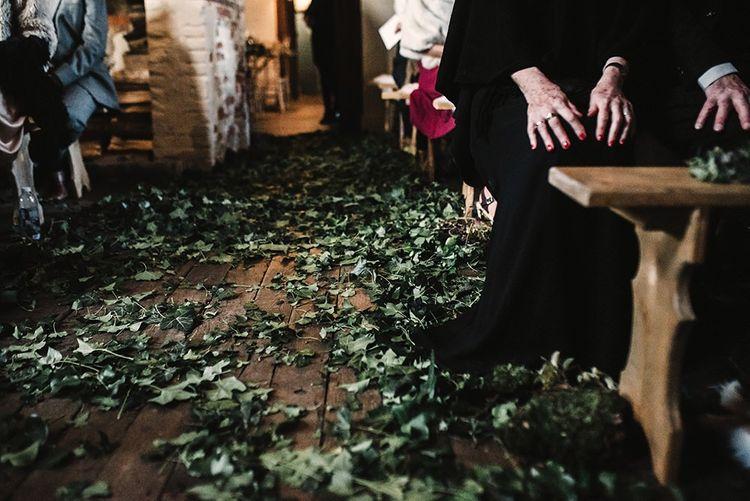 Locally foraged foliage decor at intimate gothic wedding ceremony